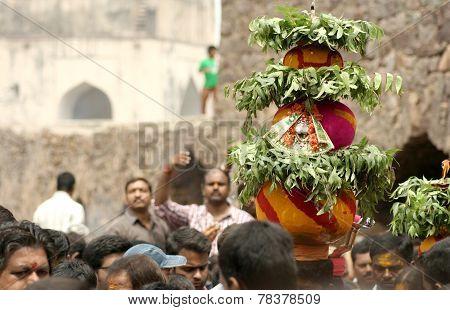Hindu devotees carry Bonam to the temple