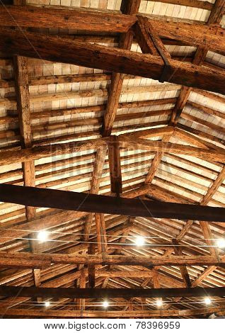 ancient restored roof with wooden beams and the lamps poster