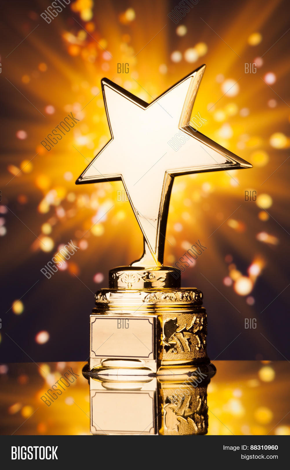Gold Star Trophy Against Shiny Image Photo