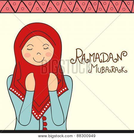 Young Muslim lady offering Namaz (Islamic Prayer) on occasion of holy month Ramadan Kareem celebration.
