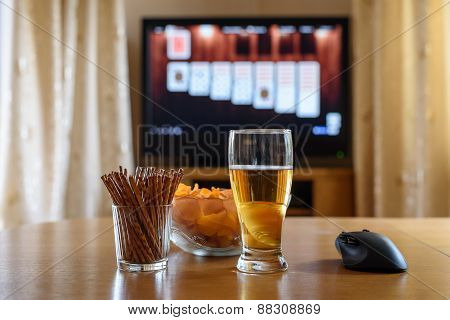 Playing Card Game On Big Tv Screen With Snacks&alcohol
