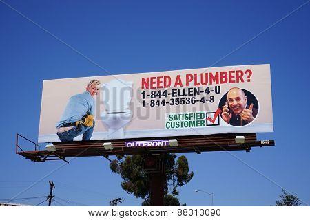 LOS ANGELES - APR 17: Matt Lauer pranks Ellen DeGeneres with a huge billboard in which she is shown as a plumber on April 17, 2015 in Los Angeles, California