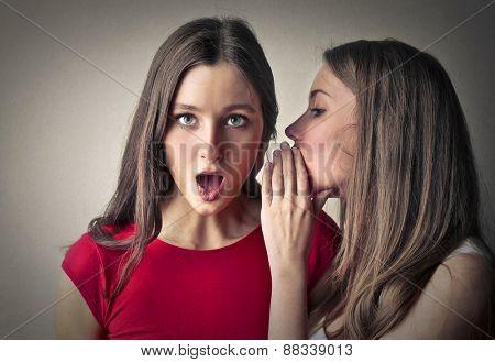 Sisters whispering secrets