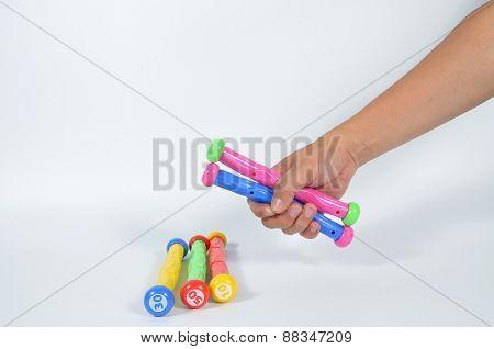 Man Hand Holding Many Diving Sticks
