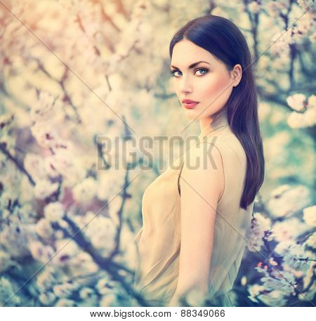 Spring fashion girl outdoors portrait in blooming trees. Beauty Romantic woman in flowers. Sensual Lady. Beautiful Woman Enjoying Nature. Romantic beauty in fantasy orchard poster