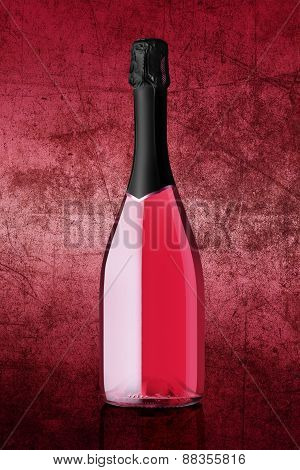 bottle of sparkling wine on colorful pink background