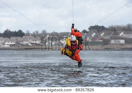 GALWAY IRELAND - APRIL 12: Irish Coast Guard crew display a water rescue training over Lough Atalia as part of the anual Galway Watersports Show on April 12 2015 in Galway Ireland.