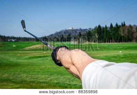 Golfer Is Pointing Witha A Golf Club