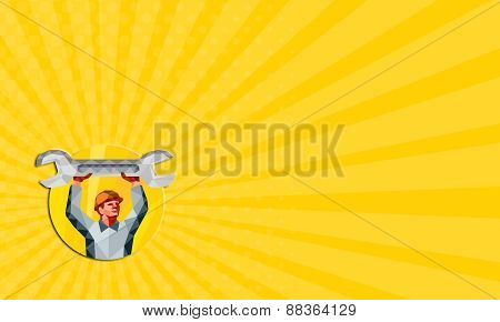 Business card showing Low Polygon style illustration of a mechanic wearing hat holding spanner wrench above his head looking to the side set inside circle on isolated background. poster