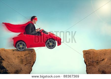 Man In A Car Jumping A Ravine