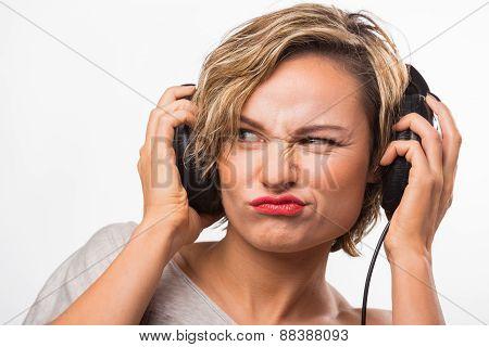 Girl in headphones. Blonde listening to music on stereo headphones