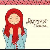 Young Muslim lady offering Namaz (Islamic Prayer) on occasion of holy month Ramadan Kareem celebration. poster