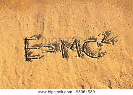 Einstein's Formula Handwriting On The Sand.
