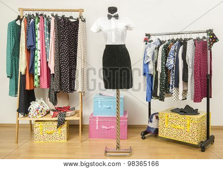 Dressing Closet With Polka Dots Clothes Arranged On Hangers.