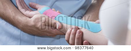 Hand With Kinesio Tape