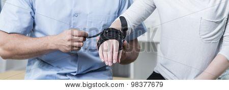 Doctor Applying Stabilizer