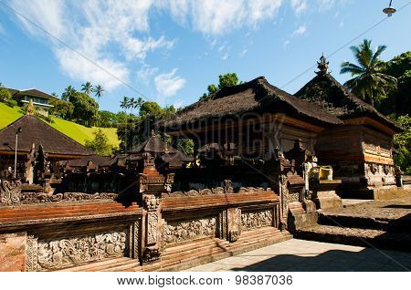 A man bathes in holy water pool in Tirta Empul temple