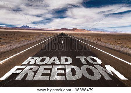 Road to Freedom written on desert road