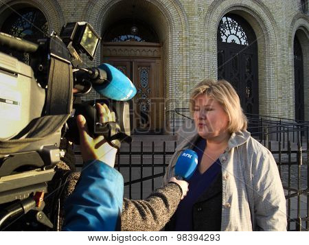 Erna Solberg in 2008 outside the Norwegian parliament building