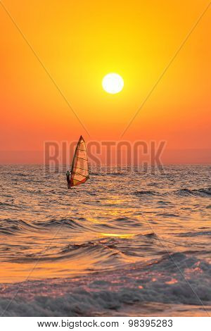 Windsurfer Silhouette At Sea Sunset. Summertime Watersports Concept