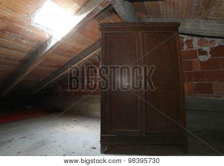 Wooden Wardrobe In The Dusty Attic