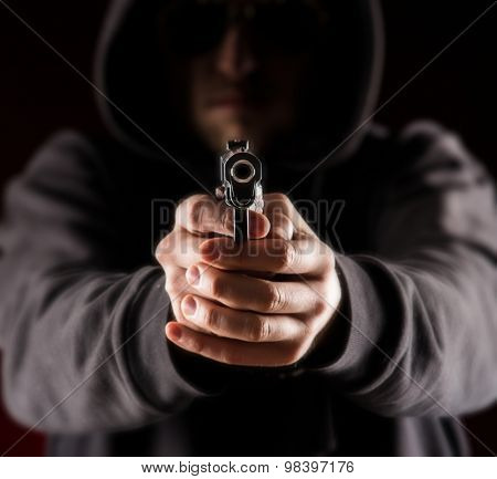 Killer with gun.