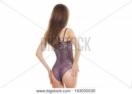 Slim young girl in sexy body with supple buttocks turned her back to the camera isolated on white background