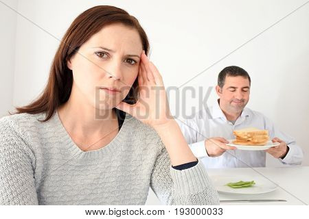 Young Woman Upset When Her Partner Eat And Enjoys Carbohydrates