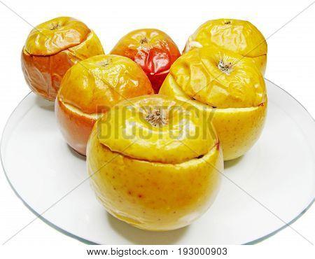 fruit dessert goup of baked stuffed apples on plate