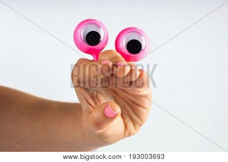 Funny Character Creature Looking Surprised With Open Mouth, Depicted With Female Hand And Googly Eye