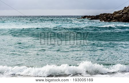 Strong Wind, Sea Waves And The Coast Or Beach.