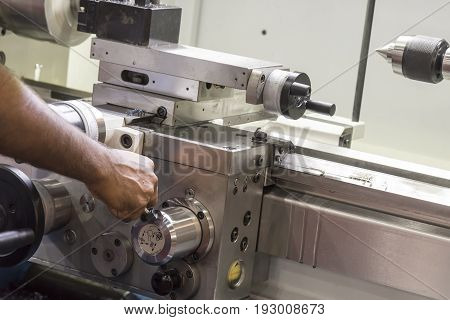 The operator use the lathe machine.Manual worker operate metal working