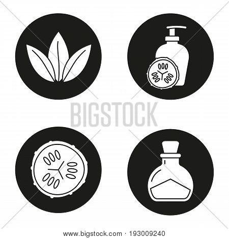 Spa salon glyph icons set. Cucumber slice and lotion container, salt bottle, loose leaves. Vector white silhouettes illustrations in black circles