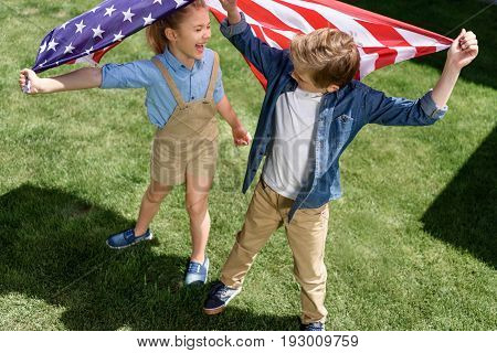 Adorable Happy Brother And Sister Waving American Flag, Celebrating 4Th July - Independence Day