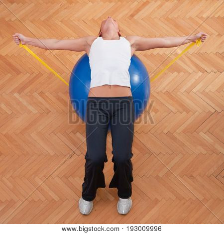 Exercise With Elastic Band And Fitness Ball, Color Image, Indoors