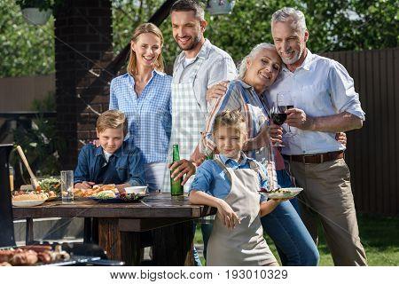 Happy Caucasian Multi-generational Family Having Picnic On Patio At Daytime