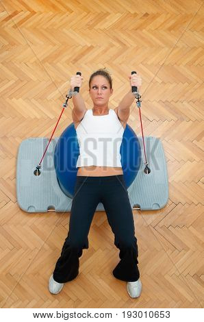 Workout With Resistance Bands And Exercise Ball, Color Image, Indoors