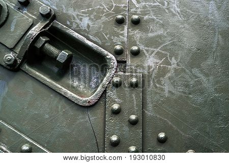 Abstract Green Industrial Metal Background Texture With Bolts And Rivets. Old Painted Metal Backgrou