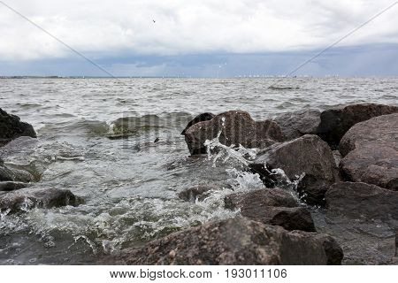 wave of water splashes on the rocks Gulf of Finland coast