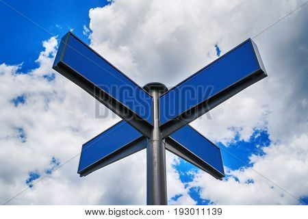 Blank blue traffic road signs in bright sky with clouds free space for text. Blank street sign on cloudy sky background copy space
