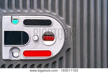Coin acceptor for payments reception free space. Coin acceptor in vending machine copy space. Grey metal background