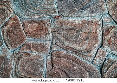 Brown stone background texture free space. Stone tile floor paving fragment. Stone wall surface with cement