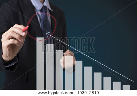 Businessman holding pen writing financial analysis graph. concept growth chart.