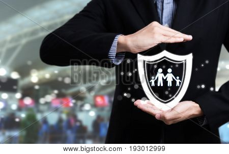 business salesman agent hand holding family concept assurance health-care insurance.