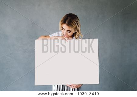 Portrait of a young professional business woman standing next to a presentation easel with copy space