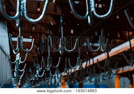 Steel hooks in the galvanizing plant. Metallurgical plant. Texture of metal. Metal industry. Background