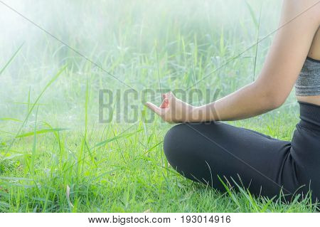 woman practicing yoga day relax in nature Yoga Exercise Helps the mind to concentrate calm and shape and healthy.
