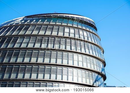 LONDON, ENGLAND - MARCH, 2017. London City Hall and Tower Bridge with clear sky in London, England .