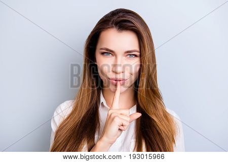 Shh! Keep My Secret. Attractive Flirty Girl In White Shirt Withnice Hairstyle Is Showing Someone To