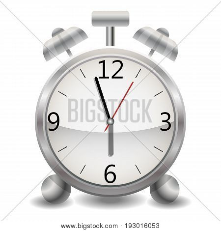 A metallic mechanical realistic alarm clock, a clock showing a few minutes to six, the end of the day, early morning.